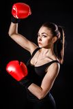 Beautiful young woman in a red boxing gloves Royalty Free Stock Photos