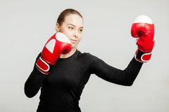 Beautiful Woman with the Red Boxing Gloves beats apercote Attractive Female Boxer Training. Stock Photos