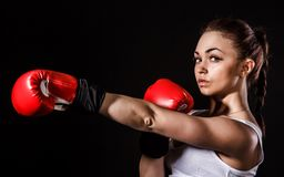 Beautiful young woman in a red boxing gloves Royalty Free Stock Images