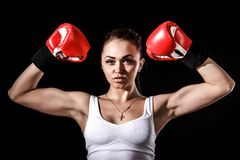 Beautiful young woman in a red boxing gloves Stock Image