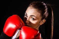 Beautiful young woman in a red boxing gloves Royalty Free Stock Photography