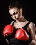 Beautiful young woman in a red boxing gloves Stock Photo