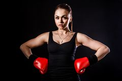 Beautiful young woman in a red boxing gloves Stock Images