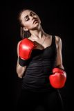 Beautiful young woman in a red boxing gloves Royalty Free Stock Image