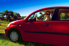 Beautiful young woman in red car Royalty Free Stock Images