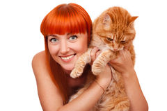 Beautiful young woman with a red cat Royalty Free Stock Image