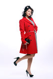 Beautiful young woman in red coat Royalty Free Stock Photos