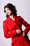Beautiful young woman in red coat Royalty Free Stock Image