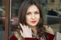 Beautiful young woman in red coat and her smile Royalty Free Stock Photo