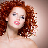 Beautiful young woman with red curly hair. stock photography