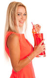 Beautiful young woman in red dress with a glass of ice tea Stock Photography