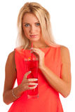 Beautiful young woman in red dress with a glass of ice tea Royalty Free Stock Photo