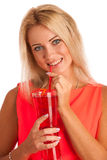 Beautiful young woman in red dress with a glass of ice tea Royalty Free Stock Photography