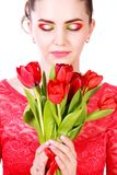 Beautiful young woman in a red evening dress Stock Images