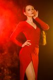 Beautiful young woman in a red evening dress Stock Image