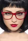 Beautiful young woman with red glasses. Stock Image