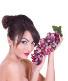 Beautiful young woman with red grape Stock Photography