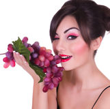 Beautiful young woman with red grape Royalty Free Stock Photography