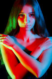Beautiful young woman in red, green and blue lights Royalty Free Stock Photography