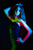 Beautiful young woman in red, green and blue lights Royalty Free Stock Photo