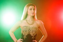 Beautiful young woman between red and green lights Royalty Free Stock Image