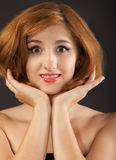 Beautiful young woman with red hair Royalty Free Stock Photography