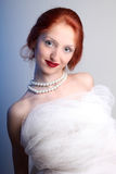 Beautiful young woman with red hair bride Royalty Free Stock Photos
