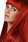 Beautiful young woman with the red hair Stock Photos