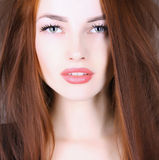Beautiful young woman with red hair Stock Images