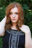 Beautiful young woman with red hair Stock Photos
