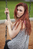 Young Woman with Beautiful Auburn Hair on a Swing Royalty Free Stock Photos