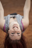Young Woman with Beautiful Auburn Hair on a Swing Royalty Free Stock Images