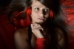 A beautiful young woman with the red headphones Stock Images