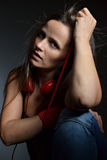 A beautiful young woman with the red headphones Royalty Free Stock Photos