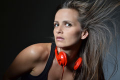 A beautiful young woman with the red headphones Stock Photos