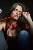 A beautiful young woman with the red headphones Royalty Free Stock Photography