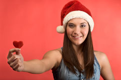 Beautiful young woman with red heart Royalty Free Stock Photography