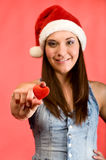 Beautiful young woman with red heart Stock Photography