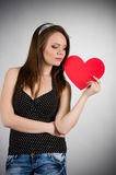 Beautiful young woman with red heart Royalty Free Stock Photo