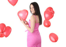 Beautiful young woman with red heart balloon Royalty Free Stock Photo