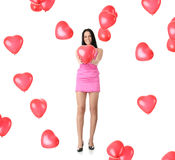 Beautiful young woman with red heart balloon Royalty Free Stock Photos