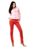 Beautiful young woman in red jeans Royalty Free Stock Photos