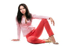 Beautiful young woman in red jeans Royalty Free Stock Image