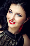 Beautiful young woman with red lips and blue eyes Stock Images