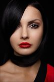 Beautiful young woman with red lips and long black Royalty Free Stock Photography