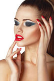 Beautiful young woman with red lips and nails Royalty Free Stock Image