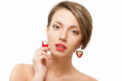Beautiful young woman with red lips. Portrait of beautiful young woman with red lips and earrings, looking at camera Stock Photos