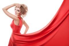 Beautiful young woman in red long dress Stock Photo