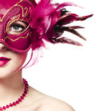 The beautiful young woman in a red mysterious venetian mask royalty free stock images