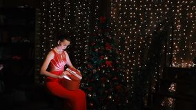 Beautiful young woman in red open box with Christmas Gift stock footage